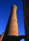 The Kalyan minaret or Minâra-i Kalân (Pesian/Tajik for the 'Grand Minaret') is part of the Po-i-Kalyan mosque complex and was designed by Bako and built by the Qarakhanid ruler Arslan Khan in 1127.<br/><br/>  The minaret is made in the form of a circular-pillar brick tower, narrowing upwards, with a diameter of 9m (30ft) at the bottom, 6m (20ft) at the top and a height of 46m (150ft) high.<br/><br/>  The Kalyan Minaret is also known as the 'Tower of Death', as for centuries criminals were executed by being tossed off the top.<br/><br/>  Bukhara was founded in 500 BCE in the area now called the Ark. However, the Bukhara oasis had been inhabitated long before.<br/><br/>  The city has been one of the main centres of Persian civilization from its early days in 6th century BCE. From the 6th century CE, Turkic speakers gradually moved in.<br/><br/>  Bukhara's architecture and archaeological sites form one of the pillars of Central Asian history and art. The region of Bukhara was for a long period a part of the Persian Empire. The origin of its inhabitants goes back to the period of Aryan immigration into the region.
